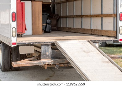 inside of a moving van partially loaded with furniture
