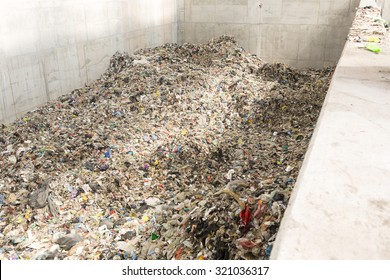 Inside of a new modern waste plant. Pile of waste rwady to be processed in energy.