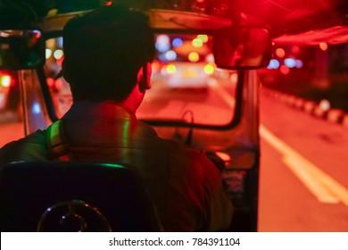 inside night taxi thai or tuk tuk  thailand  blur