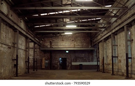 Inside of old abandon factory. A structure interior of industry warehouse. An abandon old factory with no equipment and machine. Image of rustic factory room structure made from iron and steel.