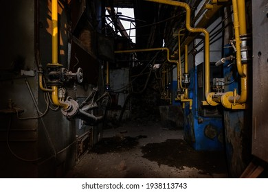 Inside old collapsed industrial building. Old rusty pipeline.