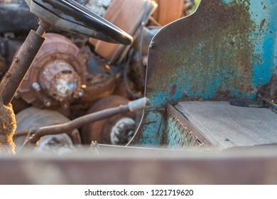 inside old truck in a junkyard