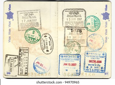 Inside page of a well traveled european passport with all kinds of stamps from different customs: taipei, china, thailand, Hongkong, america