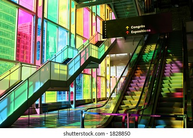 Inside the Palais des Congrès in Montréal. The colored glass windows filter the sunlight to create this nice effect.