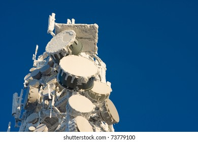 Inside perspective of a tall communications tower in snow day