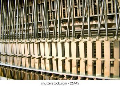 Inside a piano accordion, bottom area.
