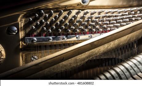 inside piano internal wooden structure mechanisms closeup
