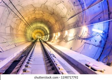 "Inside of railway tunnel illuminated by color lights. ""Ejpovice tunnel"". Railway corridor construction"