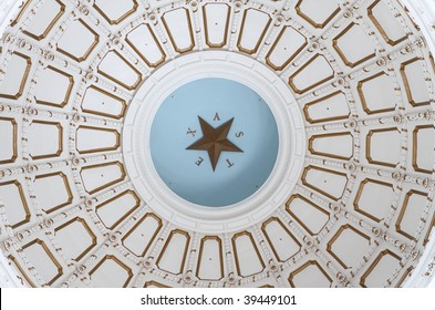 """Inside the rotunda of the Texas State Capitol Building, the domed ceiling with the word """"Texas"""" and the lone star."""