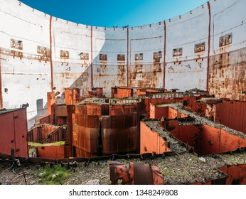 Inside round ruined and abandoned nuclear rector room in Crimean destroyed NPP, rusty steel equipment of nuclear turbine generator