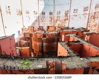 Inside round ruined and abandoned nuclear reactor room in Crimean destroyed NPP, rusty steel equipment of nuclear turbine generator