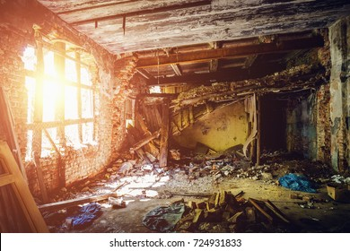 Inside ruined abandoned house building after disaster, war, earthquake, Hurricane or other natural cataclysm, sun light in dark dirty room