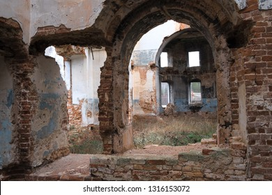 inside the ruined Church in Russia, old brick walls, shabby ceilings, fallen paint Windows on the street