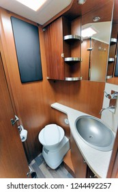 Inside of RV with washroom toilet sink shower cabinet