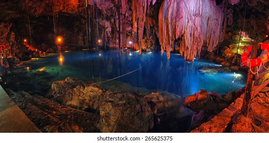 Inside a sinkhole - famous natural landmark Cenote in Mexico - cave with inner lake