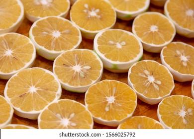 inside slice citrus orange on wood plate for wating making orange juice