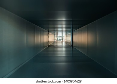 Inside square iron or metal pipe as abstract industrial background, corridor or tunnel view with light.