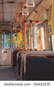 "Inside a sunny trolley bus of Lithuania (on the door is written: ""you can buy your ticket from the driver"" and prices indicated"