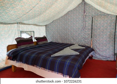 Inside tent camp with bed, blankets and pillows for the tourist camp in Pangong Tso, Ladakh, India.