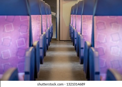 Inside the train bogie with empty chairs, Second class train interior, Seat places in backside of modern public intercity train, Netherlands.