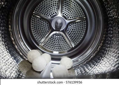 inside of a tumble dryer with dryer balls