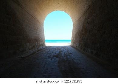 Inside a tunnel that leads to the sea shore, natural scene, l'Aliga beach, Mediterranean, Catalonia, Costa Dorada, L'Ametlla de Mar, Tarragona, Spain