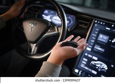 Inside Viev of Contemorary Last Technologies Tesla Model X. Close-Up of Steering Wheel and Displays of Car. Key on Forefront. Kyiv, Ukraine, F-Drive showroom 13 of february 2018.
