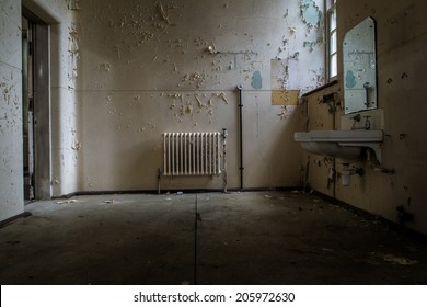 inside view of a deserted room with an old radiator