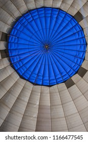 Inside view of hot air balloon with blue and geometric shape pattern in the top surround by white