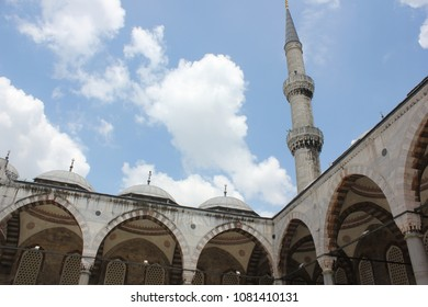 Inside view of a mosque courtyard looking at the tower