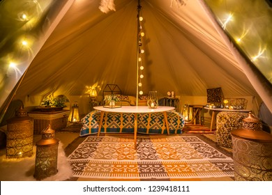 inside view of white glamping tent
