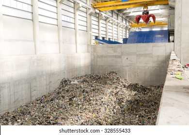Inside of a waste management facility. Treatment and disposal of waste. Prevention of waste production through in-process modification, reuse and recycling. Convert waste materials into new products.