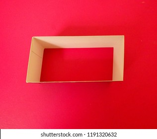 inside white carboard rectangular empty and bottomless