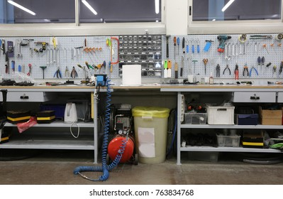 inside a workshop with large workbench and a large number of tools for machining