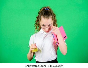 Insight and invention. Educative experiment. Chemistry fun. Schoolgirl with colorful chemical liquids. Having fun with chemistry. Education concept. Safety measures. Small kid study. Chemistry lesson.