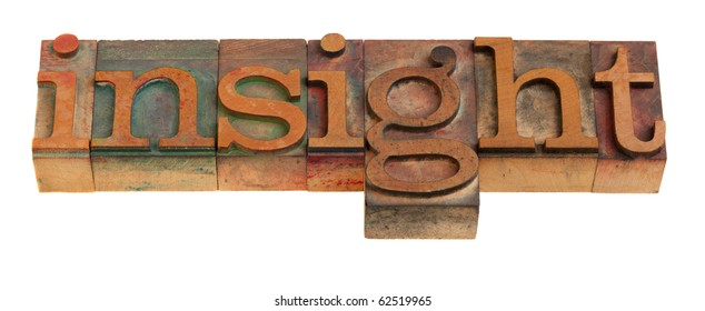 insight - word in vintage wooden letterpress printing blocks isolated on white