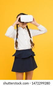 Insights into immersive virtual reality in real classrooms. Changing digital experiences way we learn and create. Digital virtual future and innovation. Little child in VR headset. Virtual education.