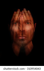 Insomnia conceptual image - sleepless man with hands over open eyes