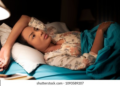 Insomnia Woman. Sad Depressed Lady on Bed. Seriously Unhappy. Sleepless at Night. The Protection and Treatment of Major Depressive Disorder Problem Concept.