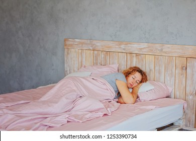 Insomnia in women during menopause / Overwork and early ascents/ Middle-aged woman sleeping asleep in bed / copy space