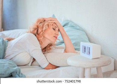 Insomnia in women / Tired mother with a headache