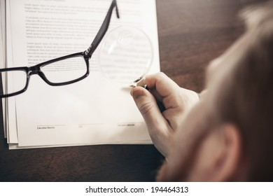 Inspecting Agreement with Magnifying Glass