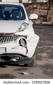 Inspection of the car after an accident on the road. Car accident or accident. The front wing and the right headlight are broken, damage and scratches on the bumper. Broken car parts or close-up.