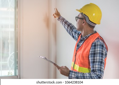 Inspection checklist review material property. Consultant house inspector holding Magnifying glass check material of property real estate for client before receive new house from agent.