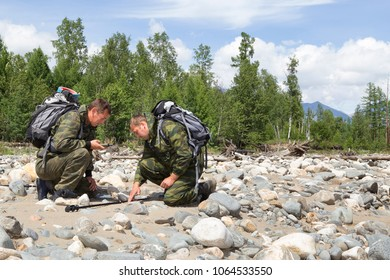 Inspection of dry riverbed by inspectors of the national park