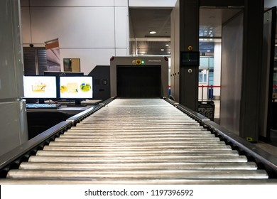 Inspection of personal belongings. Security Service. Scanner for baggage inspection. tape for movement of hand Luggage during scanning at customs at the airport