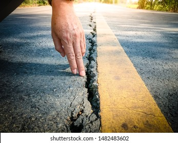Inspector to check the surface of asphalt road.