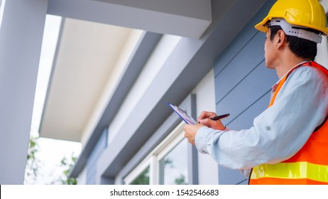 The inspector or engineer is checking the building structure and house roof specifications. After the renovate is complete