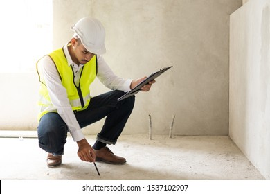 Inspector holding clipboard opening paper and checking building for renovation, engineer surveyor looking in construction site. Home inspection consultancy concept