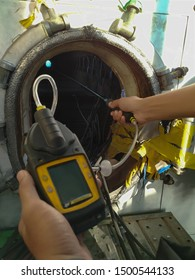 Inspector using the gas detector for detect combustible gas , flammable gas , toxic gas and oxygen depletion in a confined spaces. Focus inspection area.